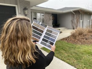 woman looking at Design samples next to a home