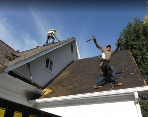 workers taking off a roof